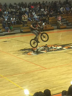 Real Encounters Bikes do a stunt during a school assembly