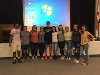 FCA leadership team with Caeleb Dressel
