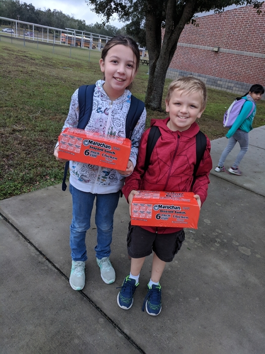 Brother and sister bringing in food for Jackson County students.