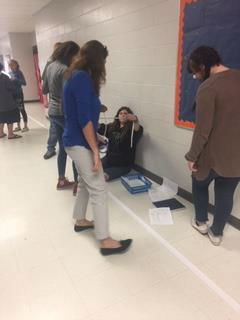 8th graders build model solar system to scale