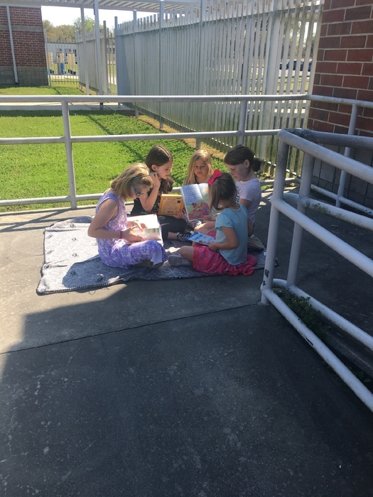 Second Graders Reading to Kindergarten Students