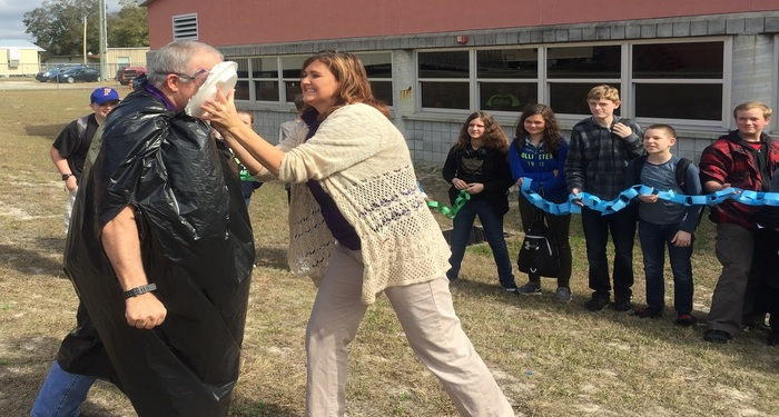 "Mr. Collins receives a ""pie"" in the face!"